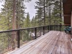 A large deck runs the length of the home and offers lake, forest and mountain views.