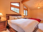 You're sure to have a peaceful slumber in the queen-sized bed in this upstairs bedroom.