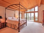 Enjoy the scenic views from the deck of this second master bedroom.