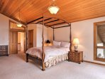 Elegance awaits in this spacious room with the 4-post bed!