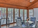 Warmth and light pour over the room through these floor-to-ceiling windows.