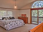 Sprawl out on this plush bed in the master bedroom.