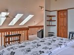The lofted master is brightened by skylights.