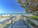 This incredible property is located only steps away from the beach.