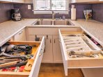 The kitchen is stocked with all the cooking tools you need to prepare meals.