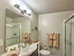 This full bathroom boasts a spacious walk-in shower.