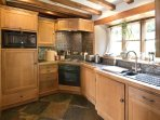 Chestnut kitchen. Ample cooking utensils and cutlery supplied in all cottages.