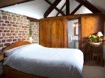 Hazelnut bedroom with en-suite bathroom accessed through hidden panel door