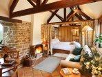 Hazelnut open plan. En-suite accessed through hidden panel. A heavy curtain divides bedroom at night