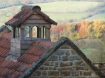 Dovecote above Beechnut Cottage. Woodland and Cotswold hills beyond.
