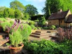 Heath Farm courtyard with water feature. Fresh scent of lavender, herbs and flowers.