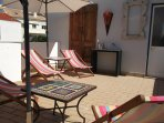 Sun terrace 3th floor with sun loungers, tables and parasols
