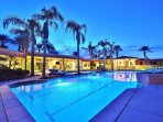 Beautiful Olympic Length (80' x 20') Pool That Features Diving Board with attached Leisure Pool and Spa