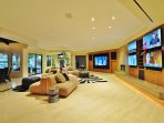 Family Room Features Four 50' LED TVs and One Immense 80' LED TV, Along with One 42' LED TV  above Sunken Wet Bar