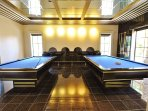 Billiard Room Equipped with Two Champion Sized Billiard Tables and Spectator Seating Along with 48' LED TV