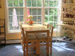 Sunny breakfast nook where we'll set the table for you in the morning.
