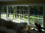 Looking out onto the front lawn from the upper floor living room