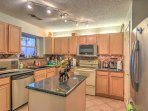 This fully equipped kitchen features all your essential cooking appliances along with ample counter space and cabinet...
