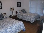 Two double beds in bedroom