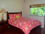 Second bedroom with a nice queen bed, garden views