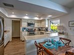Prepare home-cooked recipes in the fully equipped kitchen that features stainless steel appliances and spacious...