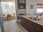 sunny alcove off fully equipped kitchen. New tile floors in 2015