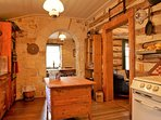 Beautiful stone arch leading into the dining room.