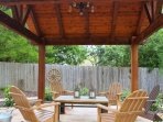 Pergola has seating for 8 guests.