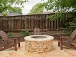 Fire pit extends from the pergola and is part of the outdoor garden.