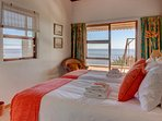 The 3rd bedroom with views of the sea through the balcony doors and the mountains through the window