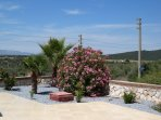 Villa set in beautiful mature gardens, with stunning view from the patio and roof terrace