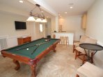 Recreational Room Featuring a Pool Table on the Ground Level