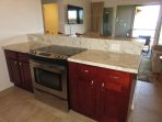 Stove, oven, plenty of granite counter space and cupboard space.