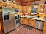 Open concept kitchen with stainless appliances including dishwasher