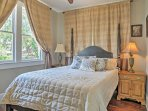 You're sure to have many peaceful slumbers in this queen-sized bed in the master bedroom.