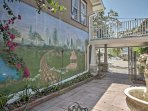 Admire the wall mural from the courtyard.