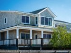 Discover the hidden treasures of Fire Island from this 4-bedroom, 2-bathroom vacation rental house with sleeping...