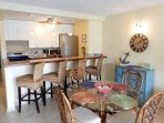Dining table for four, plus four barstools