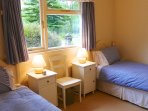 Bedroom 2 has two single beds with duvets + electric blankets. Good wardrobe + drawer space.