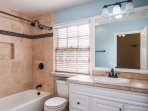 Master bathroom on first floor has shower curtain, towels, hair dryer, shampoo, conditioner, soap,TP