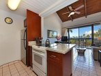 Upgraded kitchen with ocean views to enjoy while you cook.