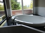 Soaker tub and two way fire place
