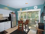 Kitchen leading to lovely porch.