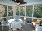 Screened in porch surrounded by lush tropical forest. Hear the wildlife while dining