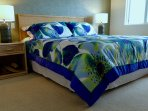 Huge master bedroom with king bed, and AC for comfort...with open window to the surf below