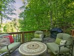 Up to 6 guests can enjoy stunning forest views from the spacious deck!