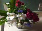 Tropical floral arrangement created by a renter with flowers and foliage found in the yard.
