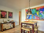 Upon entering this lavish condo, you will be amazed by the sleek white interior with vibrantly-hued paintings...