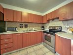 The fully-equipped kitchen has stainless steel appliances, making it perfect for preparing meals to enjoy on the...