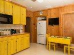 Banana Split kitchen and dining area.  Full size fridge, 2 burner stove, microwave.